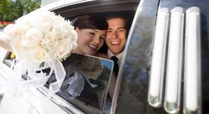 couple enjoying a wedding limo rental